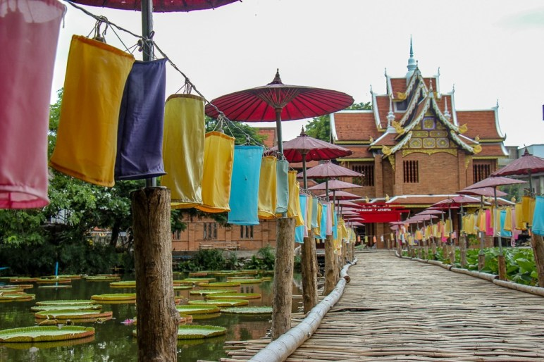 Bamboo boardwalk over Lotus Pond at Wat Ched Lin in Chiang Mai, Thailand