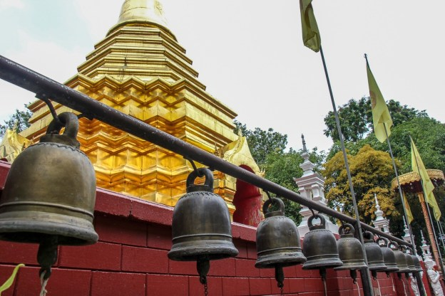 Row of hanging bells at Pan On Temple in Chiang Mai, Thailand