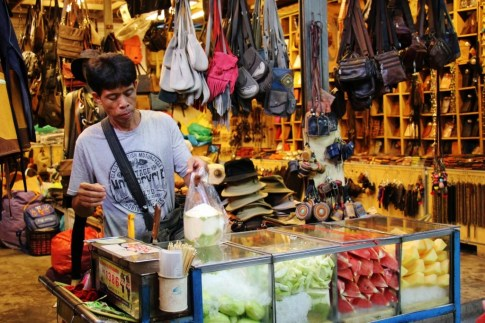 Vendor sells fresh fruit at Chatuchak Weekend Market in Bangkok, Thailand