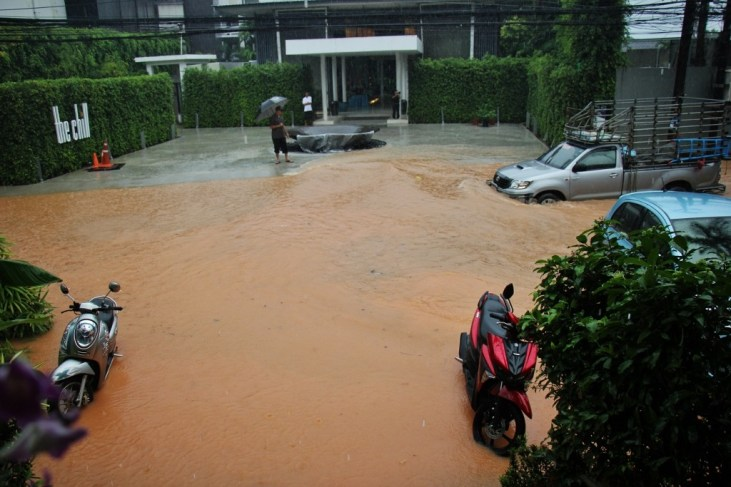 Truck drives down flooded street in Kai Bae Beach on Koh Chang, Thailand