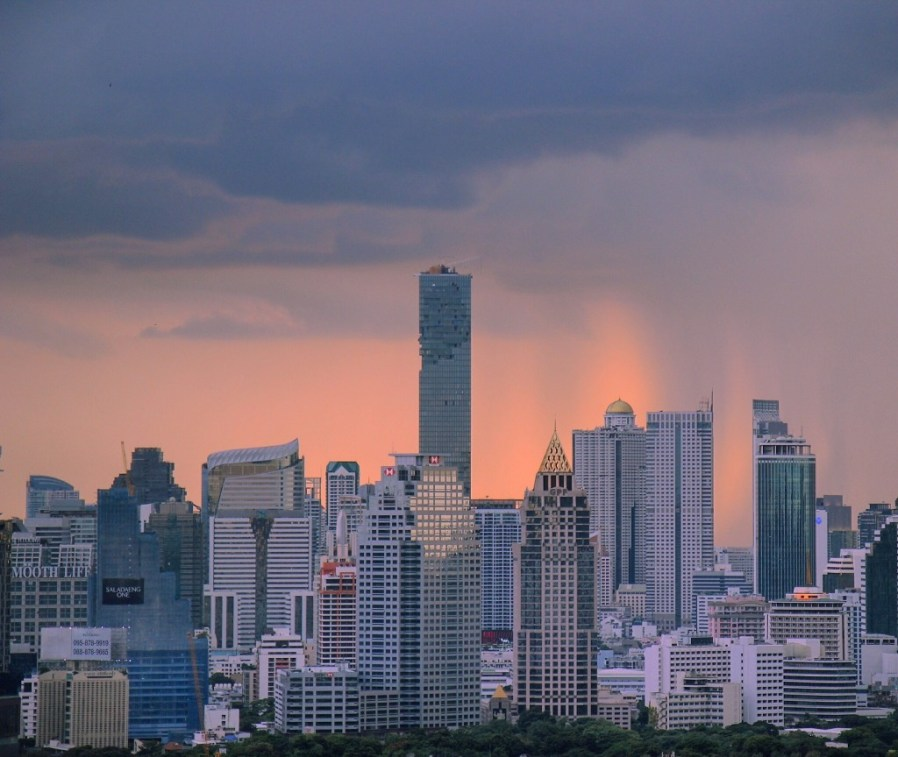 Storms at sunset from Brewski rooftop bar in Bangkok, Thailand