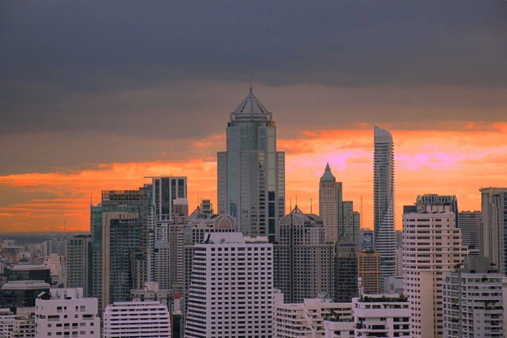Colorful sunset from rooftop bar Brewski in Bangkok, Thailand