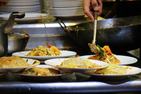 Plates of egg-wrapped pad Thai at Thip Samai in Bangkok, Thailand