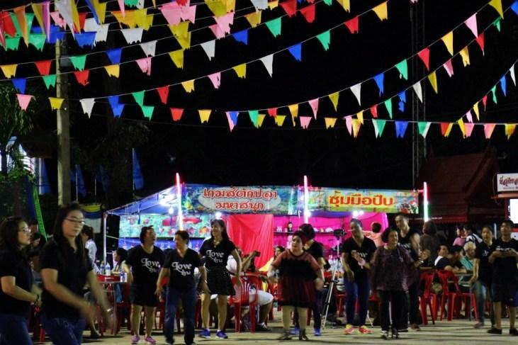 Dancing at Sunday Walking Street Market in Chiang Rai, Thailand