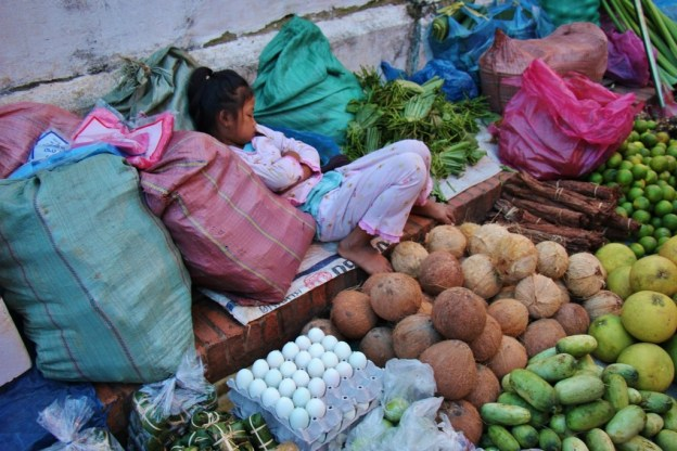 Young girl sleeps at Morning Market in Luang Prabang, Laos