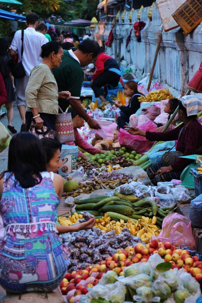 Vendors selling vegetables at Morning Market in Luang Prabang, Laos