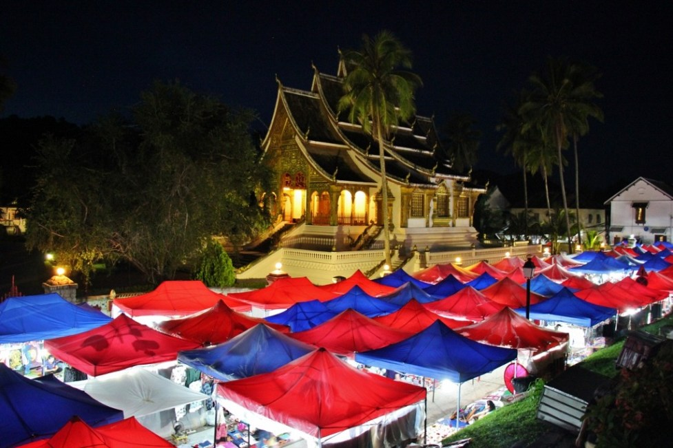 Glowing tents at Night Market and Haw Pha Bang Temple in Luang Prabang, Laos