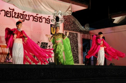 Performers dance on stage at Night Market in Chiang Rai, Thailand