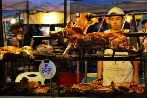 Pig roasting at Saturday Walking Street Market in Chiang Rai, Thailand