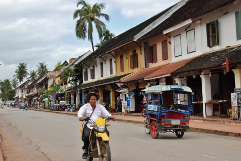 Motor scooter and tuk tuk on Sisavangvong Road in Luang Prabang, Laos