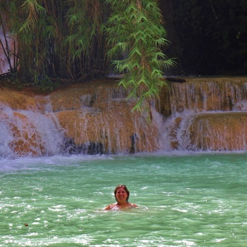 Swimming in clear, blue water at Kuang Si Waterfalls in Luang Prabang, Laos