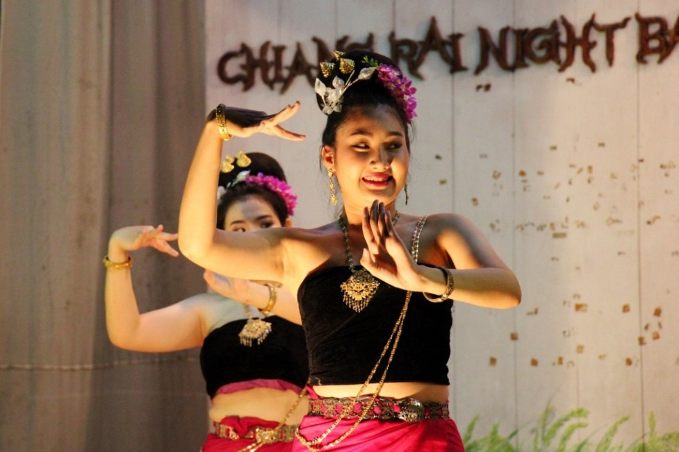 Dancers perform traditional Thai dance at Night Market in Chiang Rai, Thailand