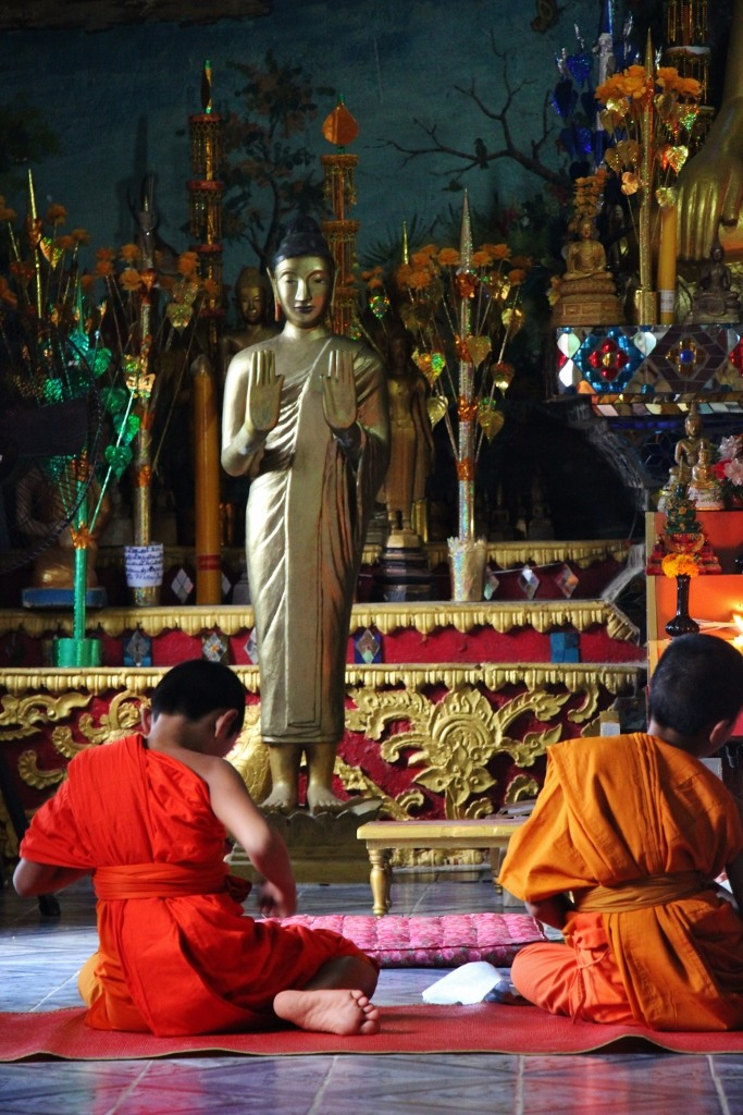 Young novice monks chanting in Temple in Pakbeng, Laos