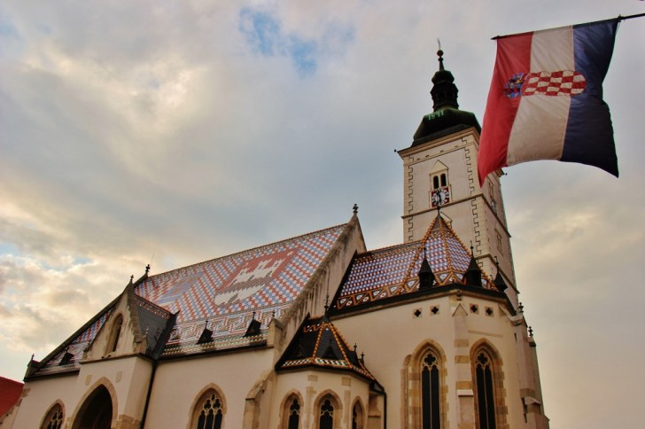 Croatian flag flying over St. Mark's Church Zagreb in Zagreb, Croatia