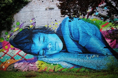 Sleeping girl street art mural at Medika in Zagreb, Croatia