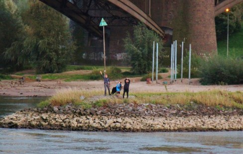 Our friends waving to our ship from the riverside in Nijmegen, Netherlands