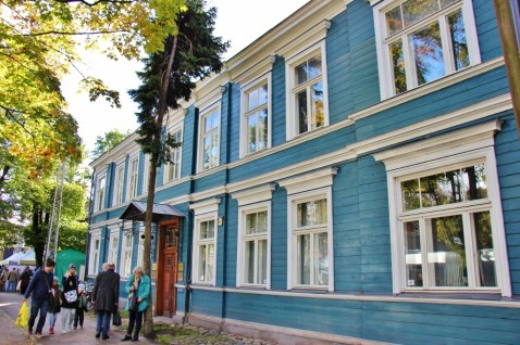 Blue renovated wooden house in Riga, Latvia
