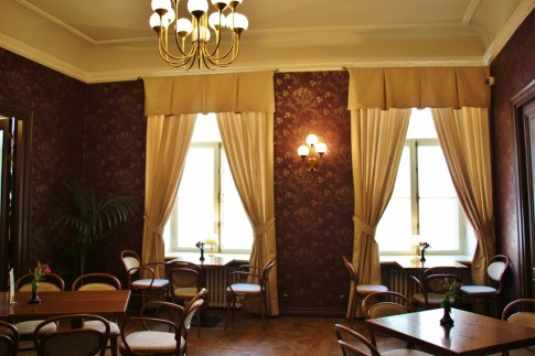 Elegant upstairs room at Maiasmokk Cafe in Tallinn, Estonia