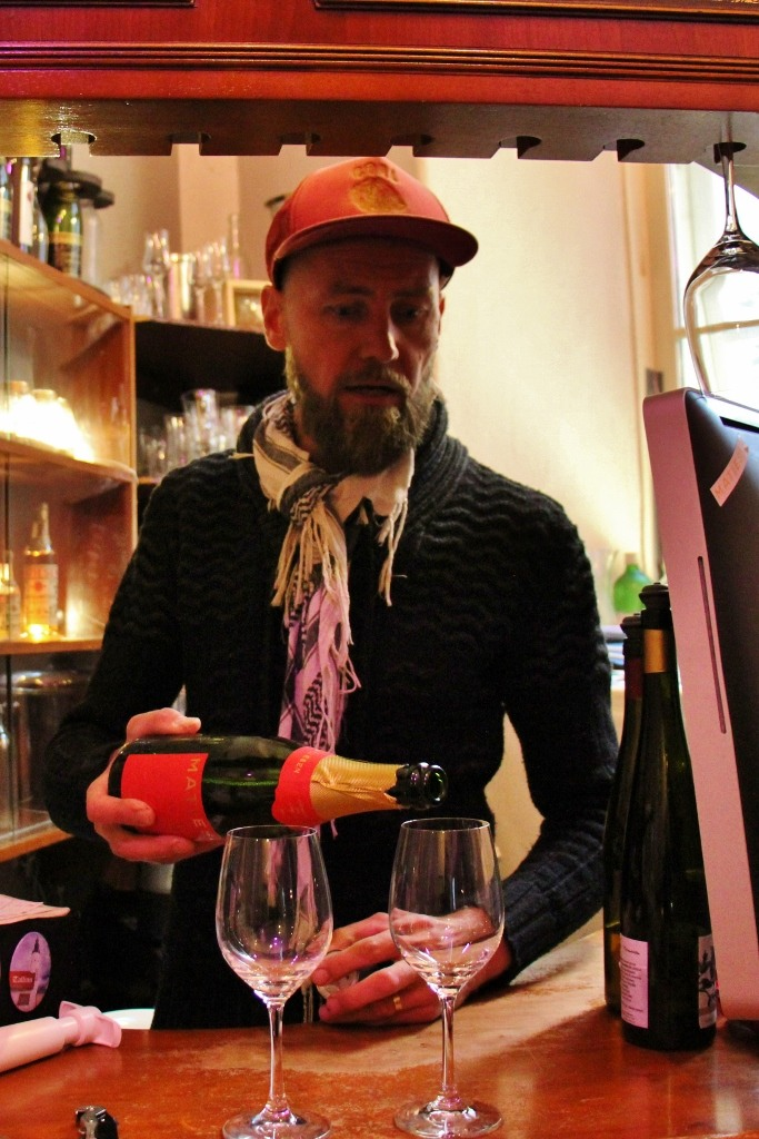 Owner pours wine tasting at Museum of Estonian Drink Culture in Tallinn, Estonia