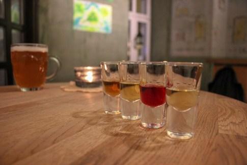 Flavored vodka tasting at Trojkat Bar in Kazimierz District in Krakow, Poland