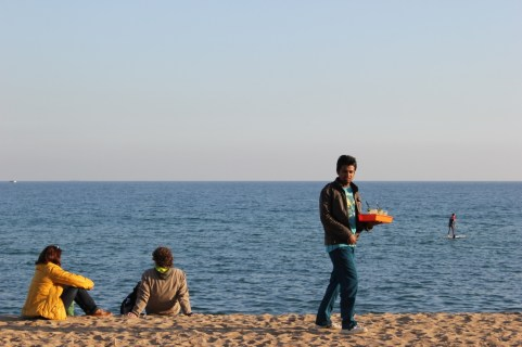 Waiter on beach in Barceloneta, Spain