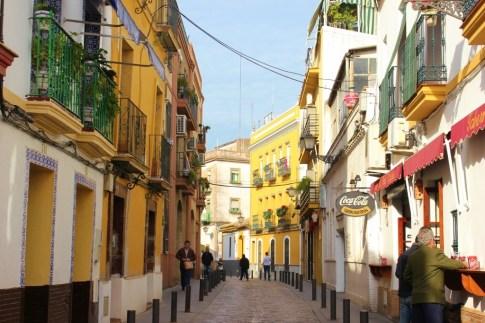 Colorful street in Triana neighborhood in Seville, Spain