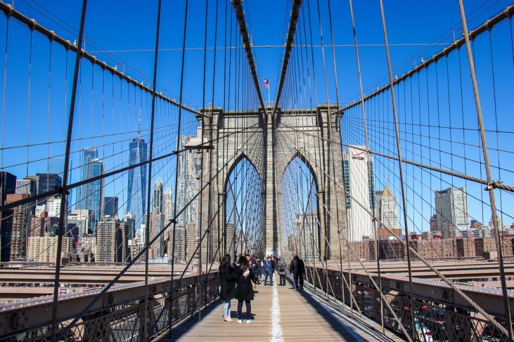 Walking across the Brooklyn Bridge in New York City, New York