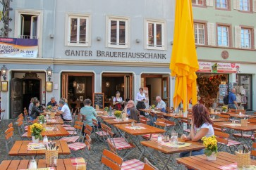 Outdoor seating at Ganter Brewery on Munsterplatz in Freiburg, Germany