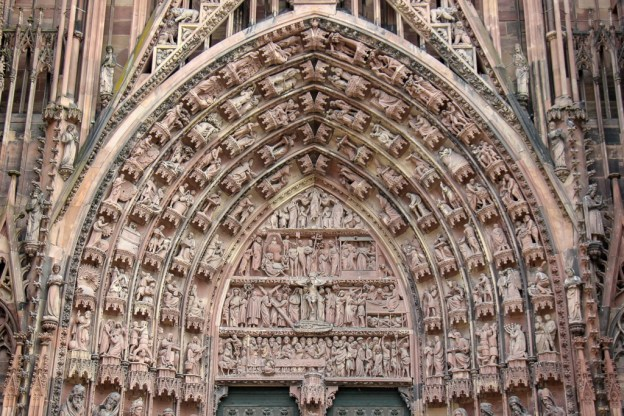 Detailed carvings on arch over main door at Strasbourg Cathedral in Strasbourg, France