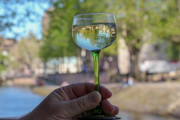 Drinking Alsace white wine riverside in Strasbourg, France