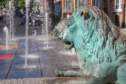 Four lions of the Four Quarters Fountain in Old Town Gdansk, Poland