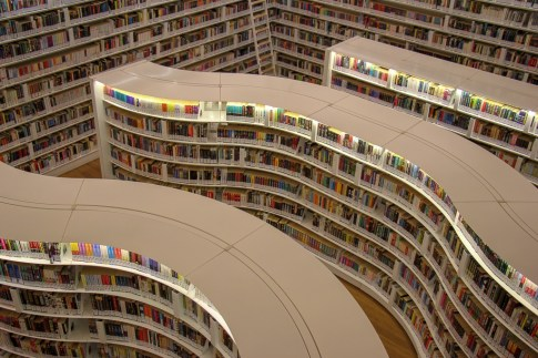 Curved bookshelves at modern Library@Orchard in Singapore