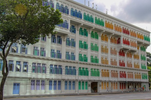 Rainbow colored shutters on Ministry of Communications building in Singapore