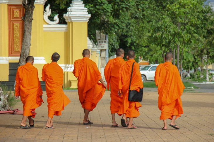 Group of monks walking through streets of Phnom Penh, Cambodia
