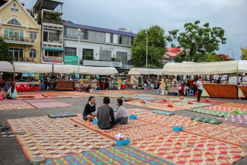 Diners sit on mats to eat at the Night Market in Phnom Penh, Cambodia
