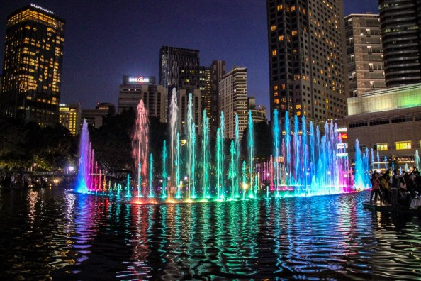 Colorfully lit fountains at Symphony Lake Light Show in Kuala Lumpur, Malaysia