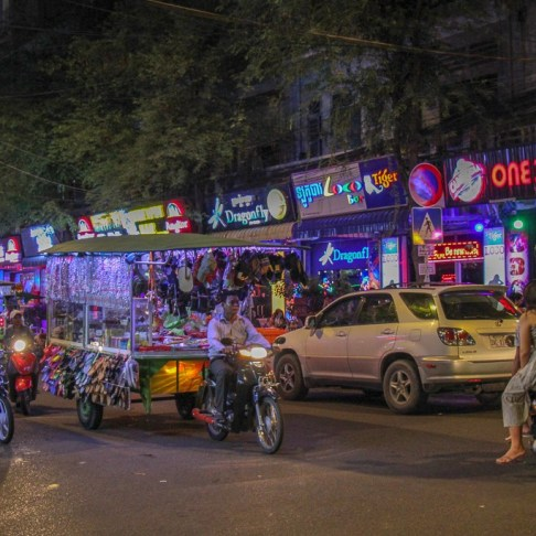 Neon bar lights on streets at night in Phnom Penh, Cambodia