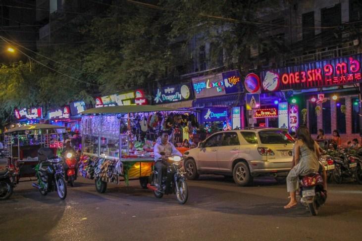 Neon bar lights on streets at night in Phnom Penh, Cambodia