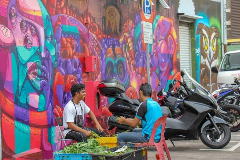 Two workers outside Sultan Arts Village in Singapore