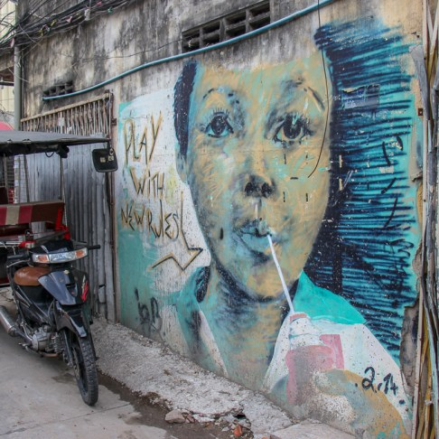 Play With New Rules street art on Street 93 in Phnom Penh, Cambodia