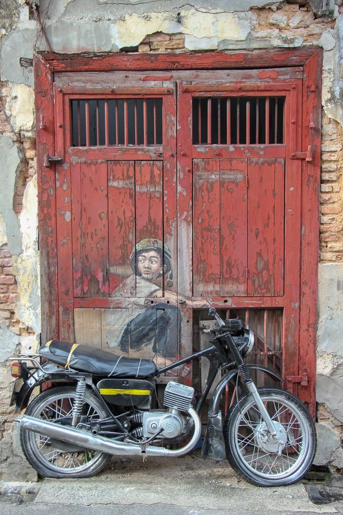Boy on Motorbike street art mural in Geroge Town, Penang, Malaysia
