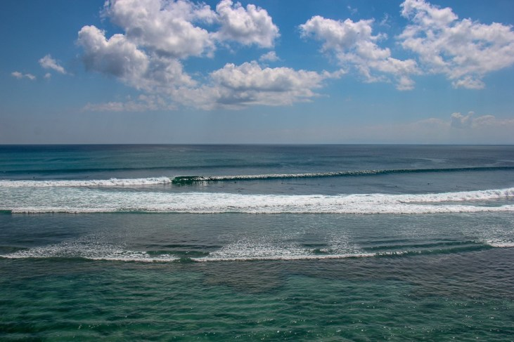Sea views and surf break at Impossible Beach in Uluwatu, Bali, Indonesia
