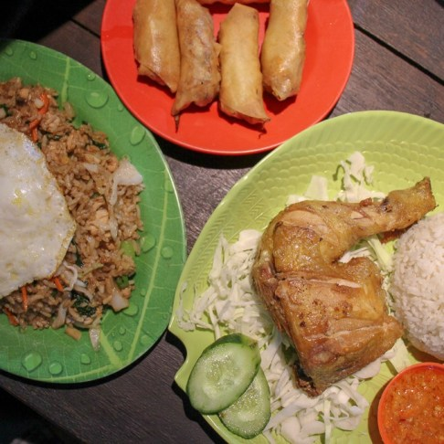 Traditional Indonesian meal of Nasi Goreng and Ayam Goreng at Nyoman Local Food in Uluwatu, Bali, Indonesia
