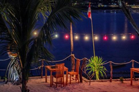 Nighttime atmospheric dining at Nusa Veranda Sunset Villas and Restaurant on Nusa Ceningan, Bali, Indonesia