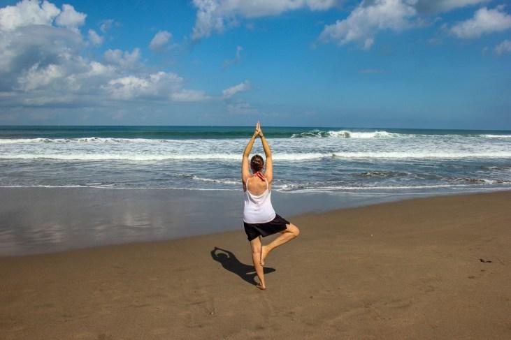 Yoga pose on the beach in Canggu, Bali, Indonesia