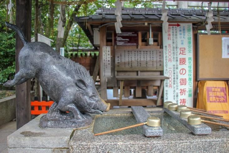 Statue of boar at Go'o Shinto Shrine in Kyoto, Japan