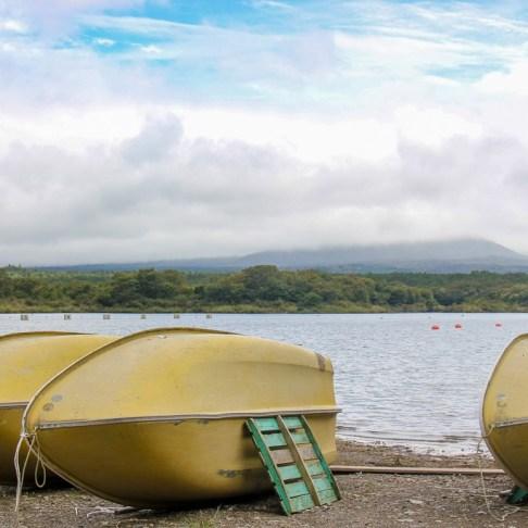 Rowboats on shore at Lake Shojiko in Kawaguchiko, Japan