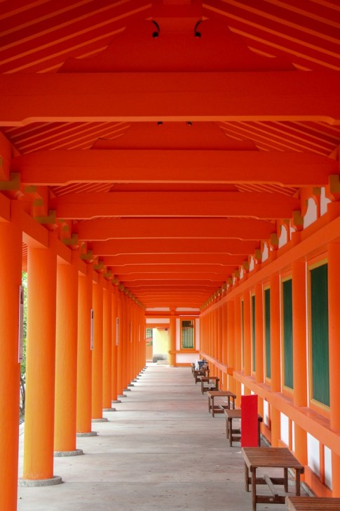 Orange gates over walkwak at Rengeoin Sanjusangendo Temple in Kyoto, Japan