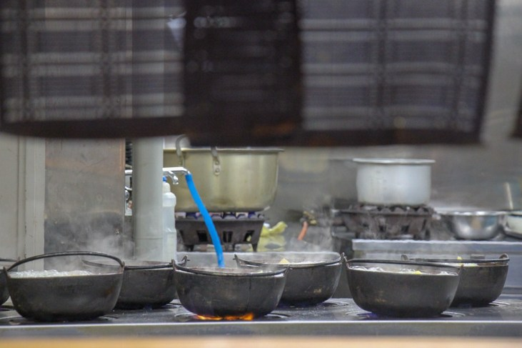 Preparing pots of Hoto Noodles in Hoto Fudo kitchen in Kawaguchiko, Japan