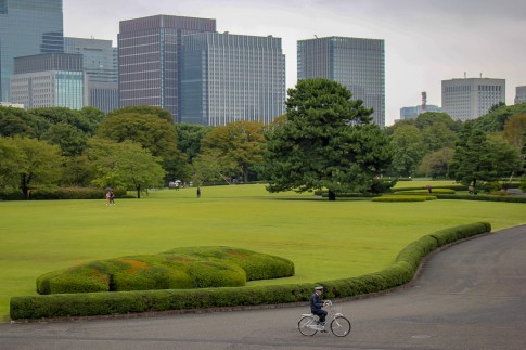 Guard rides bike at The East Gardens of the Imperial Palace in Tokyo, Japan